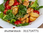 caesar salad with grilled... | Shutterstock . vector #311714771