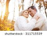 active seniors on a walk in... | Shutterstock . vector #311715539