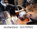 barista steaming milk in... | Shutterstock . vector #311749961