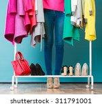 closeup of woman choosing... | Shutterstock . vector #311791001