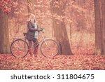 Happy Active Woman Riding Bike...