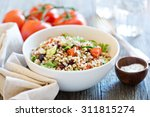 Stock photo quinoa salad with fresh tomatoes cucumbers and salad leaves 311815274