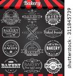 set of vintage retro bakery... | Shutterstock .eps vector #311845739