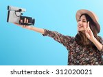 Woman With Vintage Video Camer...
