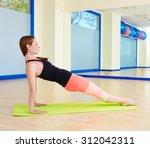 pilates woman leg pull back... | Shutterstock . vector #312042311