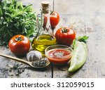 olive oil  tomato and herbs on... | Shutterstock . vector #312059015