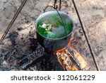 fish soup cooking in a pot on a ... | Shutterstock . vector #312061229