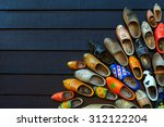 Colorful Wooden Clogs On Dark...