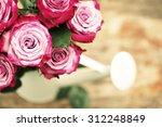 pink roses on wooden background | Shutterstock . vector #312248849