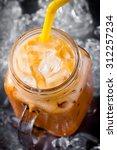 thai ice tea with milk in... | Shutterstock . vector #312257234