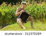 young handsome sailor in frock... | Shutterstock . vector #312370289