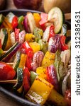 vegetable skewers on a cast... | Shutterstock . vector #312385631