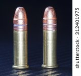 Small photo of Two rimfire cartridges that are designed for twenty two firearms