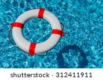 an emergency tire floating in a ... | Shutterstock . vector #312411911