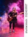 little rock star girl with...   Shutterstock . vector #312433907