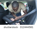 a father putting his newborn... | Shutterstock . vector #312444581