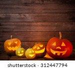 pumpkins on wooden background... | Shutterstock . vector #312447794