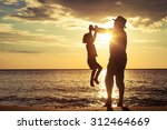 father and son playing on the... | Shutterstock . vector #312464669