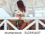 pretty young sexy tanned... | Shutterstock . vector #312541637