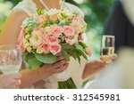 the bride holding a bouquet and ... | Shutterstock . vector #312545981