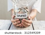 Women Hold Money Jar With Coin...