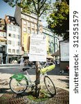 Small photo of STRASBOURG, FRANCE - AUG 22 2015:People protest ing against immigration policy and border management which asks for commitment for migrants boat disasters - placard abut freedom rights aboove bike