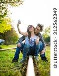 selfie with smartphone  happy...   Shutterstock . vector #312562349