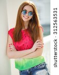 Young Smiling Redhair Woman...
