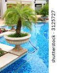 blue tiled pool and palm tree...   Shutterstock . vector #3125727