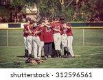 baseball team in a huddle... | Shutterstock . vector #312596561