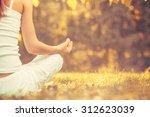 yoga outdoors in warm autumn... | Shutterstock . vector #312623039