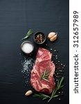 raw ribeye beefsteak with... | Shutterstock . vector #312657989