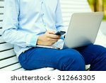 young man working with laptop ... | Shutterstock . vector #312663305