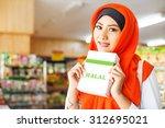 muslim woman buying halal food... | Shutterstock . vector #312695021
