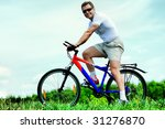 sporty mature man cycling along ... | Shutterstock . vector #31276870