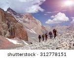 Group Of Mountaineer Walking O...