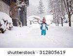 Happy Little Boy In A Snowsuit...