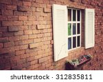 Window On A Red Brick Wall Wit...