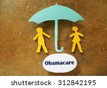 paper couple under umbrella and ... | Shutterstock . vector #312842195
