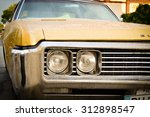 old yellow buick after rain in... | Shutterstock . vector #312898547