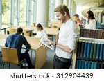 young man in the library | Shutterstock . vector #312904439