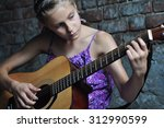 child playing acoustic guitar... | Shutterstock . vector #312990599