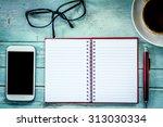 Notebook Pen Cellphone  Glasses ...