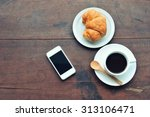 smartphone croissant and coffee ...   Shutterstock . vector #313106471
