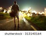 guy walks towards city lights... | Shutterstock . vector #313140164