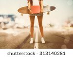 girl holds longboard  | Shutterstock . vector #313140281