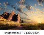 Dawn Over Red Rocks And Grass...