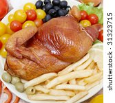 Whole roasted chicken with French fries, tomatoes and olives - stock photo