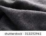 Small photo of Wool fabric in grey close up texture