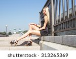 the blonde is sitting at a... | Shutterstock . vector #313265369